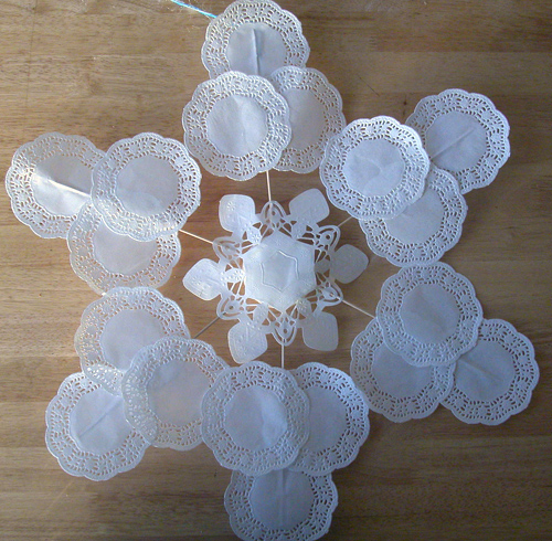 make a large snowflake decoration out of doilies dollar