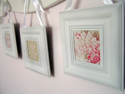 sachiko at tea rose home used dollar store frames to frame some of her favorite fabrics to create this pretty display for her daughters room
