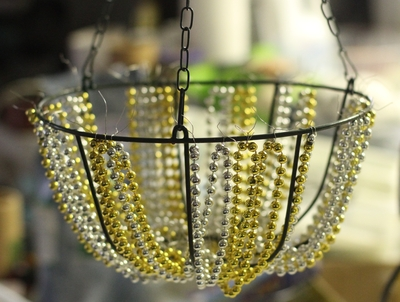 Make a beaded chandelier dollar store crafts at this point you can trim the wires in the bottom hole of the basket make sure each one is twisted securely then clip near the twisted area to make it aloadofball Choice Image