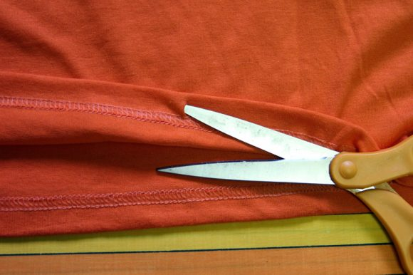 cut a slit in t-shirt hem to make casing