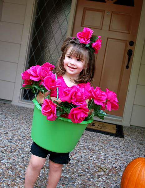 Push the petals together so that they make a circle. Tie the ribbon ends together and you now have a flower petal headband to complete your costume. Simply tie around your child's head to secure.