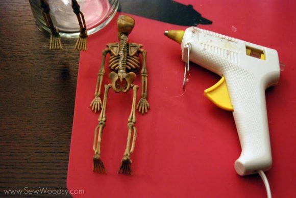 glue skeleton on vase