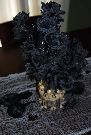 skeleton vase filled with dead flowers