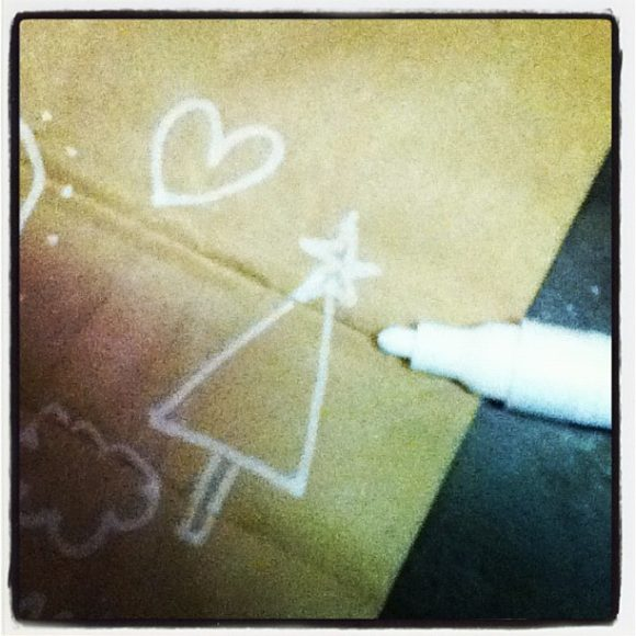 white paint marker on brown bag