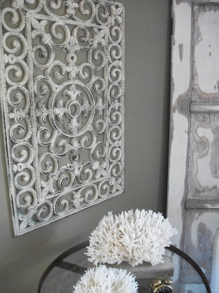 Turn a dollar store floor mat into faux wrought iron wall art - why didn't I think of that?