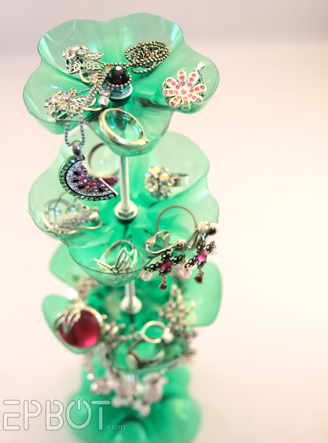 make a recycled soda bottle jewelry stand dollar store