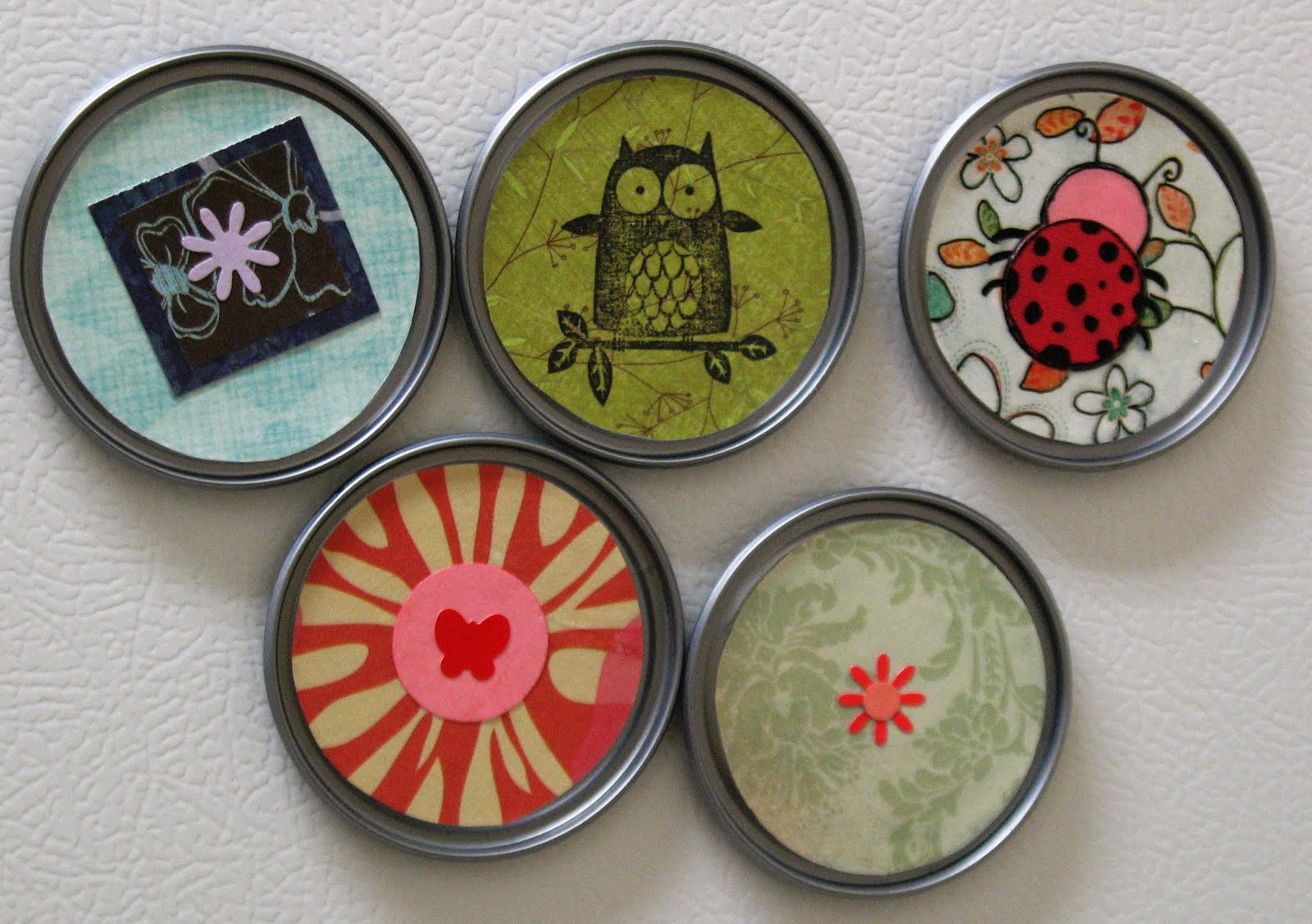 Make recycled juice lid magnets dollar store crafts for Small magnets for crafts