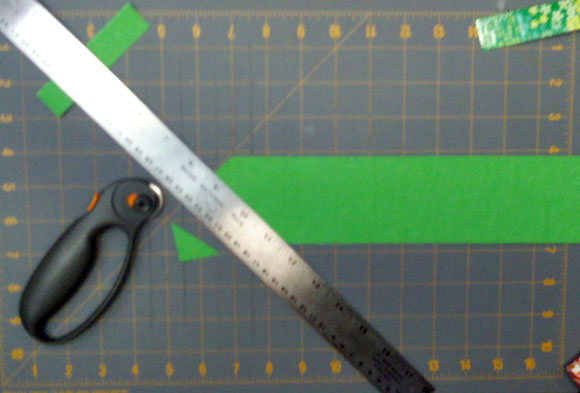 trim a mitered edge using lines on cutting mat and ruler