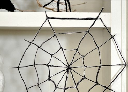 Make glitter spider webs (via dollarstorecrafts.com)