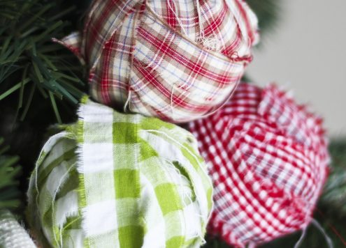 Make fabric-wrapped bulb Christmas ornaments (via dollarstorecrafts.com)