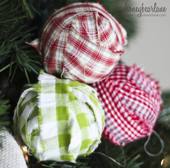 Make fabric-wrapped bulb Christmas ornaments (via dollarstorecrafts.com)