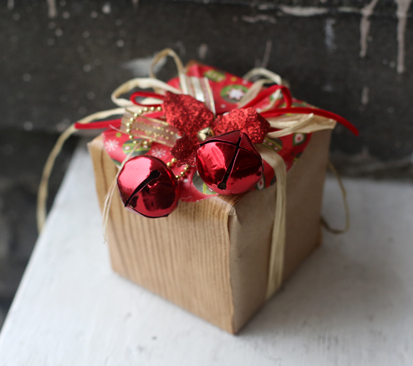 Dollar store gift wrap: faux bois contact paper, raffia & jingle bells