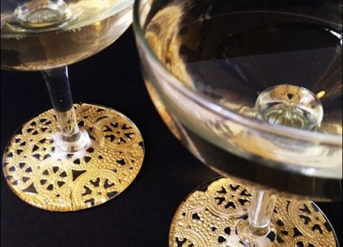 Make gilded lace champagne glasses (via dollarstorecrafts.com)
