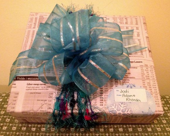 Gift embellished with ribbon and yarn