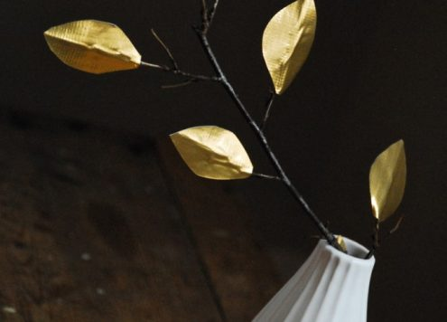 Make gold tape leaves (via dollarstorecrafts.com)