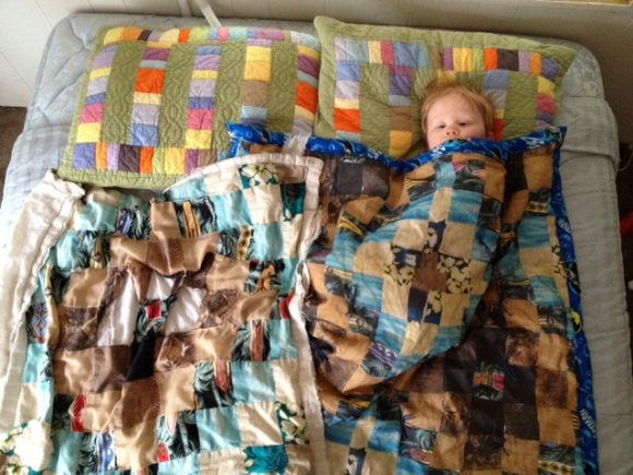 Take a picture of your child's old raggedy blanket and have it printed into fabric at Spoonflower so you can make them a new blanket!