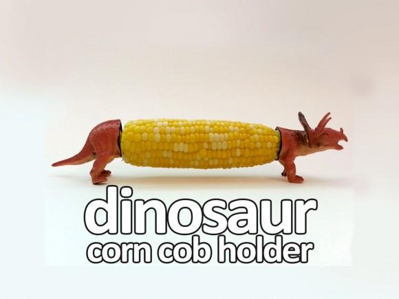DIY corn cob holders with plastic dinosaurs