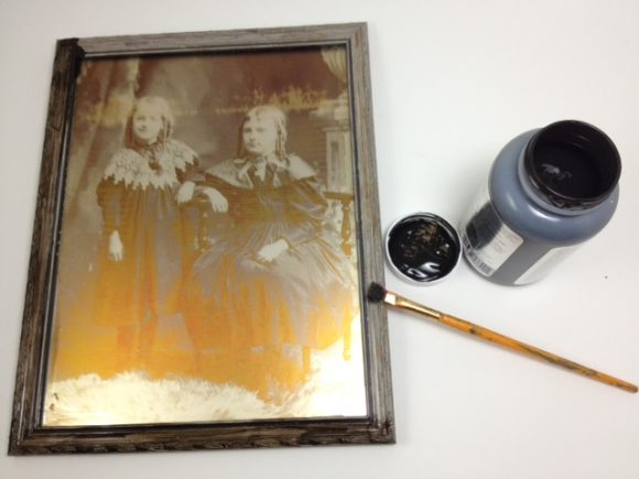 antiquing the frame to make it look old timey - click for full instructions