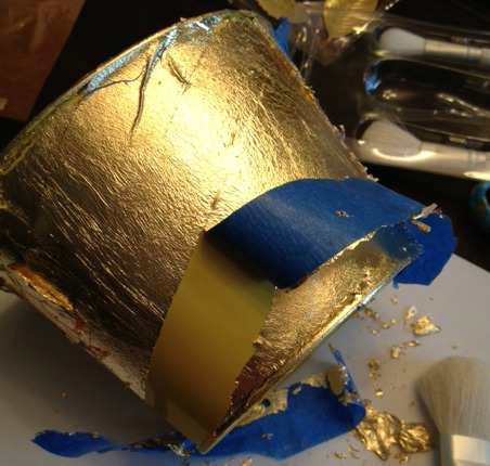 Remove masking tape from gold leafing project