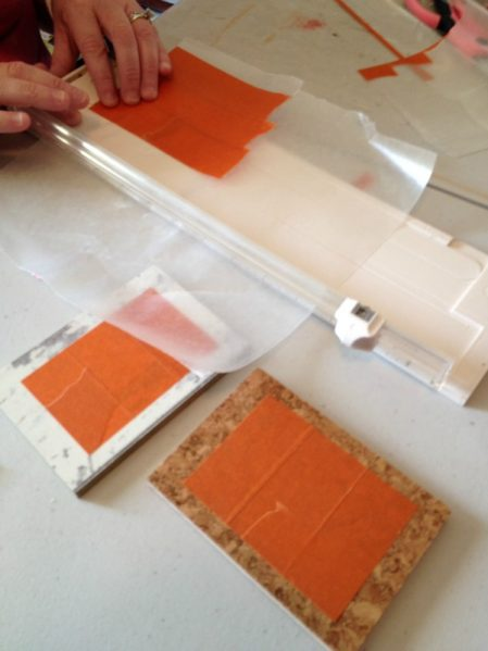 Trimming FrogTape® on wax paper to make a specific shape