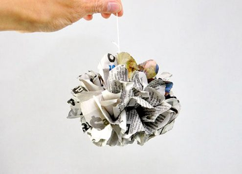 Make Newspaper Pom Poms