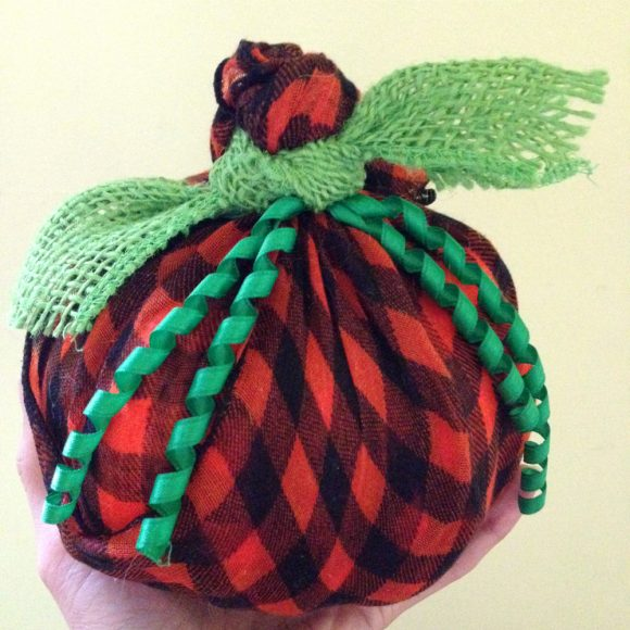 Wrapped pumpkins make great fall or Halloween decor. Here's how to make one on the cheap with dollar store items!