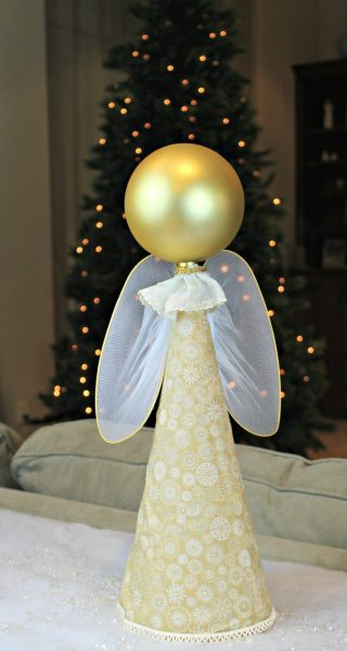 DIY Angel - This week I'd like to show you how to turn a cone and an extra large Dollar Tree ornament into a pretty piece of decor that looks like an angel.