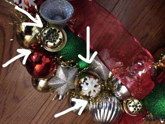A wreath made out of ornaments has become a classic Christmas decoration. If you've always wanted one, you will be happy and surprised to find out just how easy and cheap it is to create your own! You can even use scratched or damaged ornaments for this project, making it a great way to give new life to old decorations that might otherwise be destined for the trash.