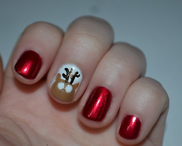 With a few simple steps, some patience, and a bit of practice- you too can rock some fabulous reindeer nail art!
