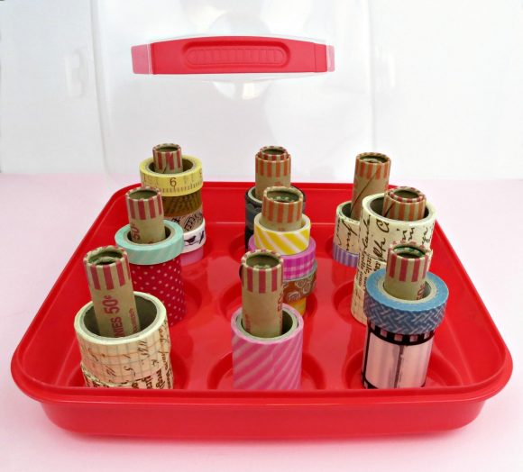 Make a DIY washi tape organizer from a cupcake carrier and free coin rolls from the bank.