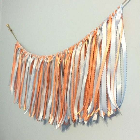 You can use new ribbon to make this fringe garland or bust your stash. The trick is in how you tie the knots.