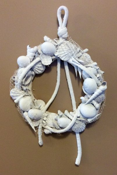 I've been feeling very inspired by seashells lately, finding different ways to work them into my decor.  One of my recent creations is this nautical shell wreath, which would be a great way to use souvenirs from a beach vacation. Even if you don't have shells and rope on hand, you should still be able to make this for just a few dollars.