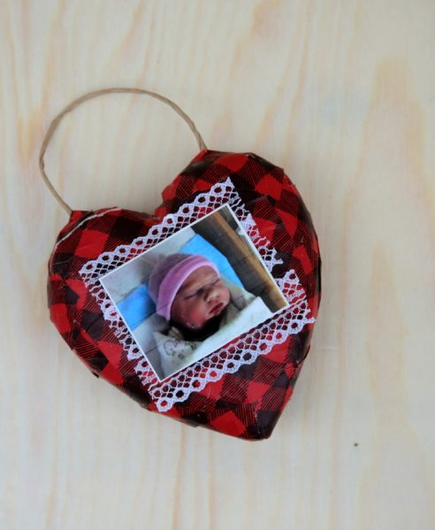 Recycled Gift Wrapping turns into this cute photo heart ornament! Easy craft