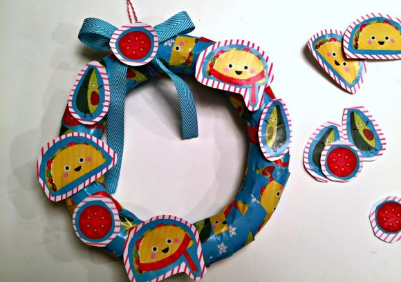 Wreath made out of recycled gift wrap - Dollar Store Crafts